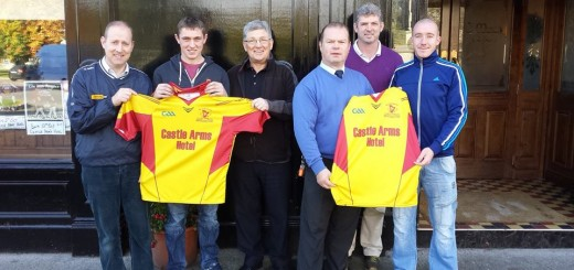 Seosamh Murphy of The Castle Arms Hotel Durrow presents a new set of Jerseys to the Harps GAA Club - October 11th 2014.